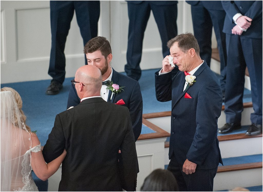 Wedding ceremony with southern charm at First Baptist Church in Manning, SC Sumter SC Charleston sC wedding photographer melissa brewer father of groom wipes away happy tears