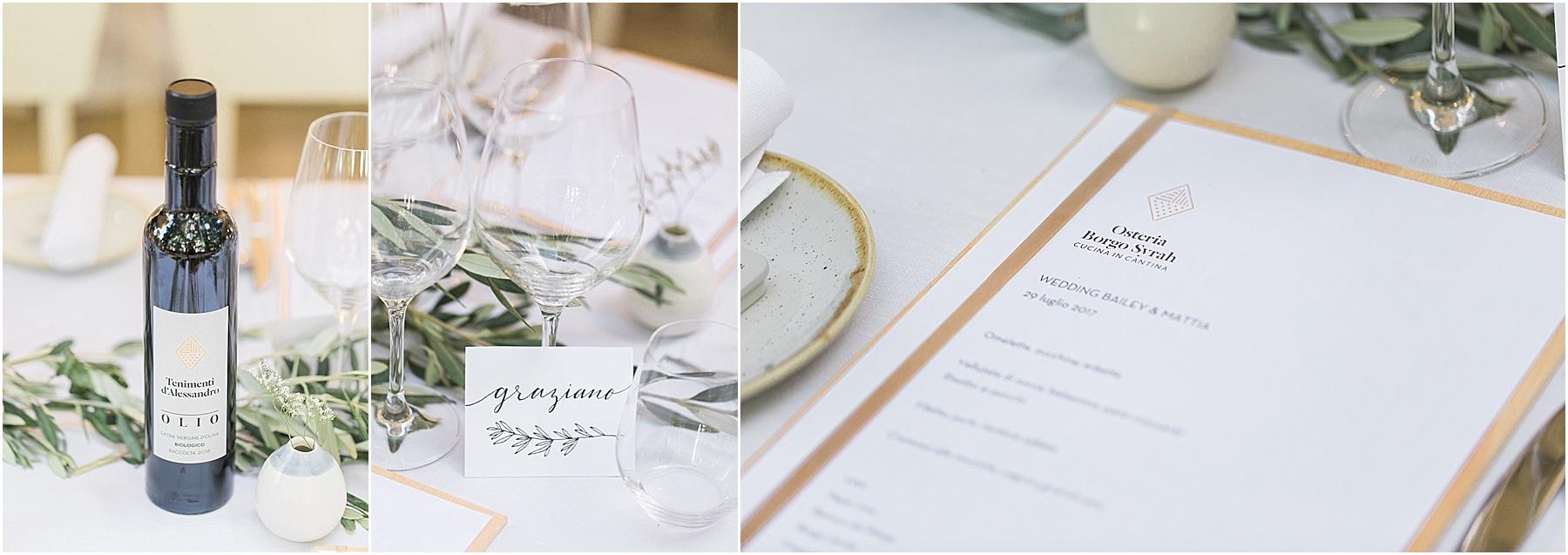 decor and beautiful bomboniere wedding favors ceramiche pottery at Osteria Borgo Syrah in Cortona Italy tablescape menus calligraphy in Italian wine glasses olio evoo