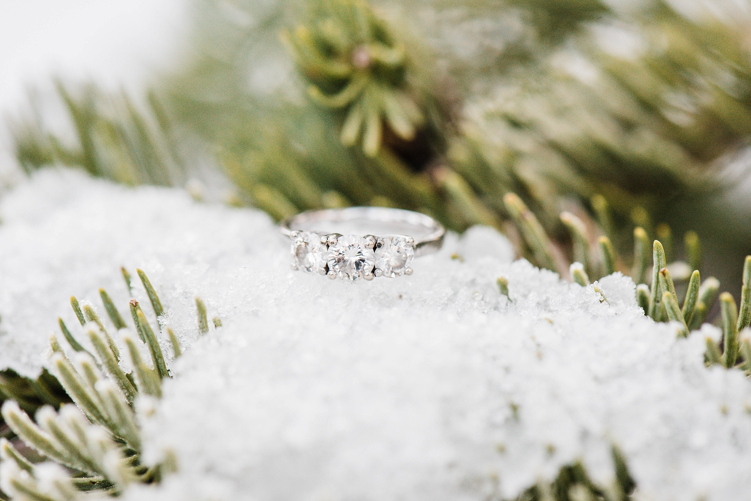 macro ring shot in the snow glacier point yosemite national park engagement session destination engagement session sunrise snowy engagement