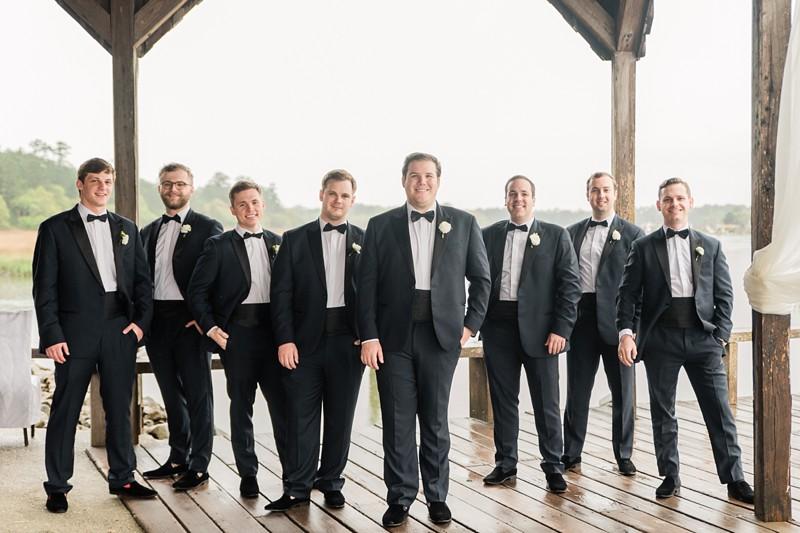 boone hall plantation wedding charleston sc spanish moss rainy wedding day gorgeous charleston wedding groomsmen on cotton dock