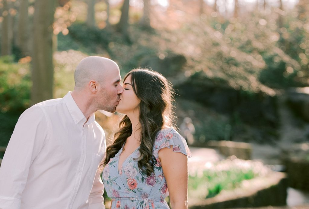 falls park on the reedy greenville engagement session bride and groom kissing springtime melissa brewer photography greenville sc weddings
