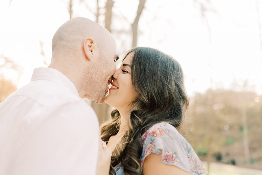 close up of bride and groom kissing backlight sunset greenville sc engagement photographer greenville sc wedding photographer melissa brewer photography