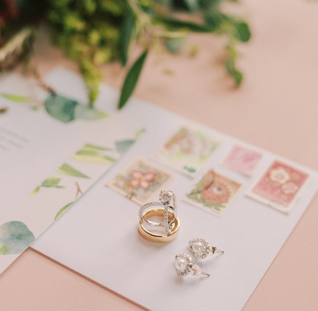 wedding details styled flatlay pink, green, and wedding rings clemson sc wedding